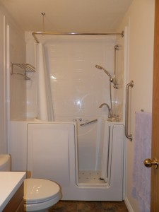 Right door Liberty with wall surround, deck extension, curtain and towel rack.