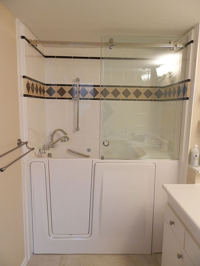 Walk In Tub With Colour Surround And Glass Doors Aquassure
